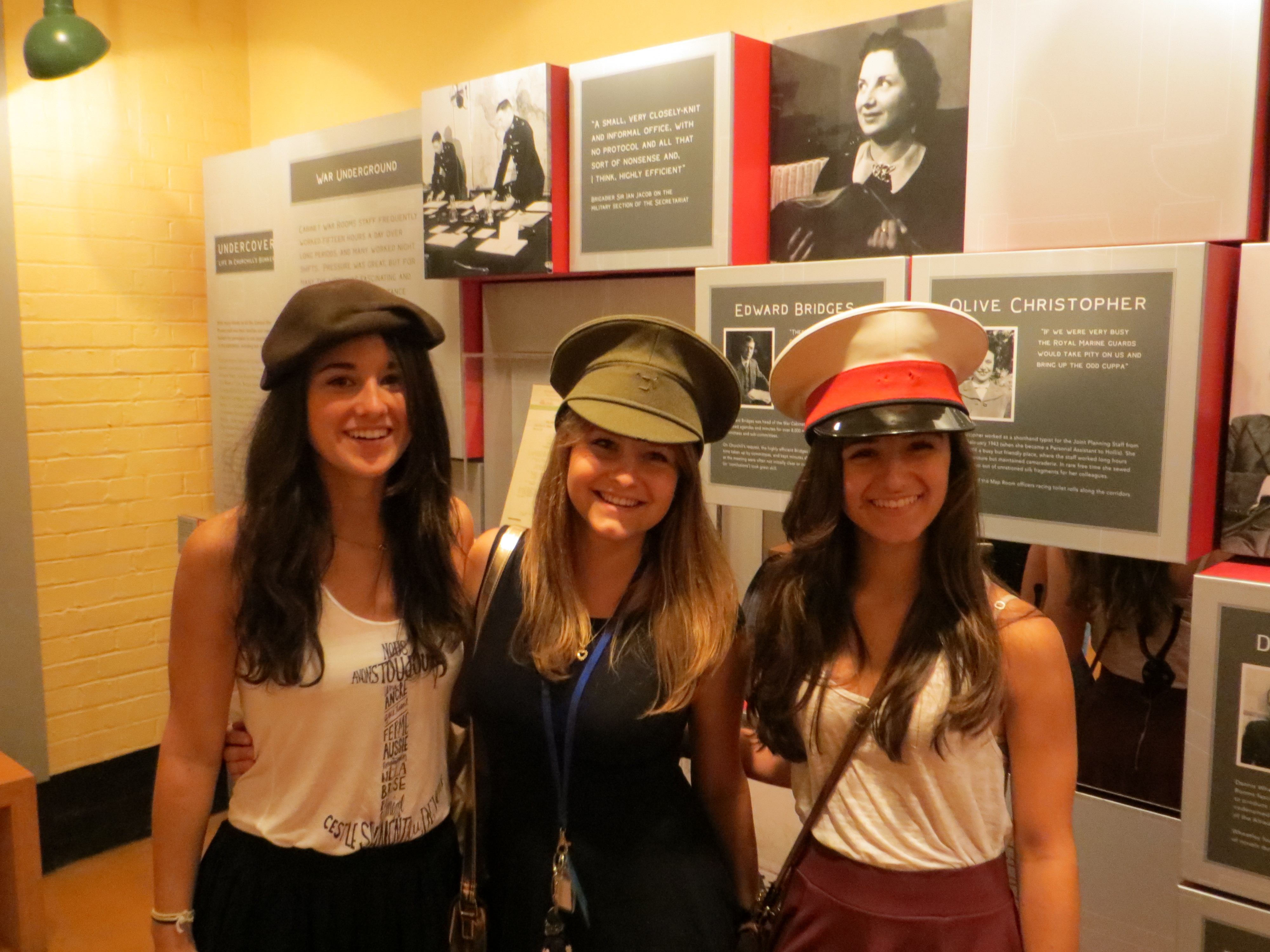 Students trying on military hats in the War Rooms!
