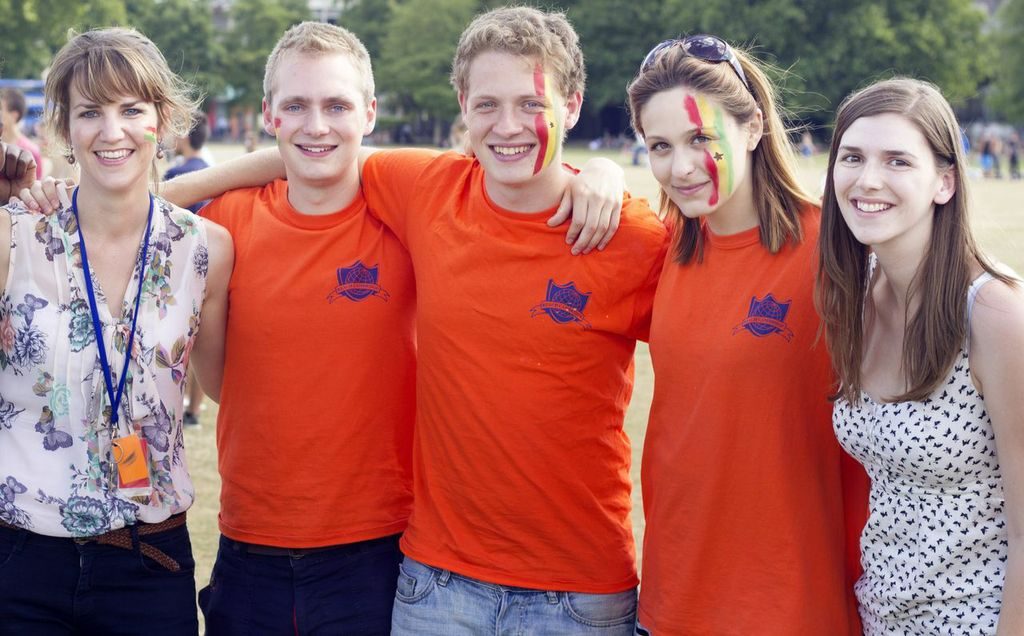 Reach Cambridge staff, faces painted with the colours of the Ghana flag on our July Sabre day