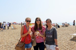 Students enjoying the sun on Brighton Beach